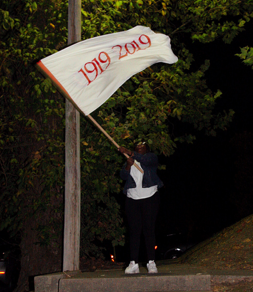 HELENA-WEST HELENA. Kai Mitchell waves one of the Remember 2019 flags in the night to welcome listening party participants